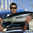 big game fisherman with saltwater tuna — Stock Photo