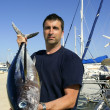Angler fishing big game Albacore tuna on Mediterranean - Stockfoto