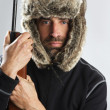 Royalty-Free Stock Photo: Hunter winter fur hat man portrait holding gun