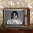 Geek mustache tv presenter in retro wood television — Stockfoto