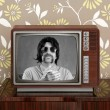 Geek mustache tv presenter in retro wood television — Stock fotografie