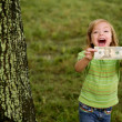 Beautifull happy little girl with dollar note — Stock Photo