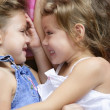 Two twin sisters in a hug, close up — Stock Photo #5500253