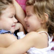 Two twin sisters in a hug, close up — Stock Photo
