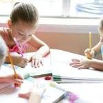 Beautiful little girls, homework at home — Stock Photo