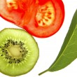 Bay tree leaf, kiwi and tomato — Stock Photo