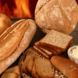 Royalty-Free Stock Photo: Bread still life with varied shapes and bakery fire
