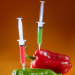 Royalty-Free Stock Photo: Green and red pepper research metaphor