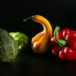 Colorful vegetables still over black - Stock Photo