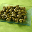Capers with vinegar snack - Stock Photo