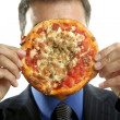 Businessman and junk fast food, pizza — Stock Photo