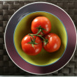 Three red tomatoes branch - Stock Photo