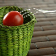 Cherry tomato, green basket with fork — Stock Photo