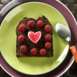 Lovely raspberryes and heart cake — Stock Photo