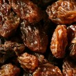 Dried raisin macro texture in a close up crop — Foto de Stock