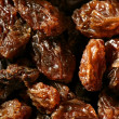 Dried raisin macro texture in a close up crop — ストック写真