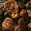 Dried raisin macro texture in a close up crop — Stock Photo