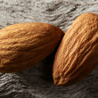 Almond macro over wood background — Stock Photo