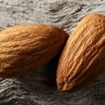 Almond macro over wood background — Stock Photo