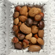 Royalty-Free Stock Photo: Wooden decorated classic white frame, varied nuts