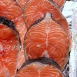 Salmon fish vivid slices in a row — Stock Photo