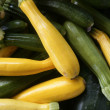 Green and yellow courgette in the marketplace - Stock Photo