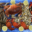 Royalty-Free Stock Photo: Crabs tellin shrimp clams and lemon