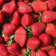 Red strawberries pattern in maket box — Stock Photo