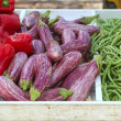 Eggplant red pepper green beans on market store - Foto de Stock