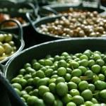 olivy v moření texturu pozadí nálevu — Stock fotografie #5502690