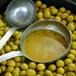 Stock Photo: Olives in pickling brine background texture