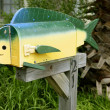Fun artistic mail box with fish shape - Stock Photo
