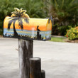 Fun artistic mail box with tropical sea paint — Stock Photo #5502869