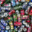 Assorted beverages cans on the trash - Stock Photo