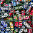 Stock Photo: Assorted beverages cans on trash