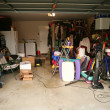 Messy abandoned garage full of stuff - Stock Photo