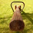Stock Photo: Old wooden teeter totter in park