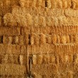 Golden straw bales wall and tools — Stock Photo