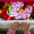 Girl hands closing her box toy container — Stock Photo
