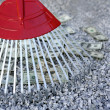 Royalty-Free Stock Photo: Cleaning black dolar money with rake, metaphor