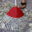 Cleaning black dolar money with rake, metaphor — Stock Photo