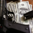 Dollar notes and gun, black pistol — Stockfoto