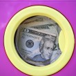 Cleaning black money dollar metaphor — Stock Photo #5503009