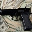 Dollar notes and gun, black pistol - Stok fotoraf