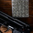 Black pistol handgun with bullet box - Stock Photo