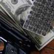 Dollar notes and gun, black pistol — Stock Photo