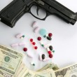 Dollar notes and gun, black pistol - Foto Stock