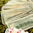 Dollar notes and poker cards, gambler tools — Stock Photo