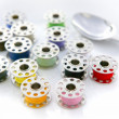 Surreal meal of color sewing reels — Stockfoto