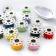 Surreal meal of color sewing reels - Stock Photo
